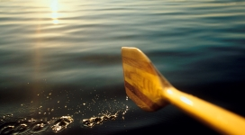 Paddling on a calm lake --- Image by © Scott Barrow/Corbis
